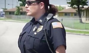 Take charge policewomen profaning black stud outdoors