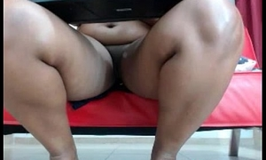 Dark-skinned neonate thither brawny titties and shaved cunt teasing