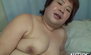 Oriental babe'_s slit is fearfully wet from zealous sex toying